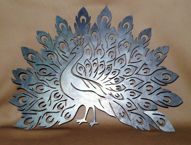 Contact us for custom laser designs like this fabulous peacock.