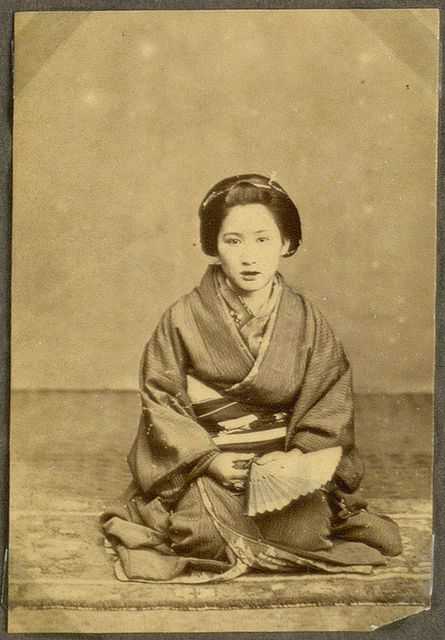 A married woman, known by her red-coloured teeth, Japan.  Photograph from Nagasaki 1868.