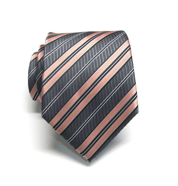 This tie is made of 100% silk, 3.25 wide at its widest point and 58 long - standard length and width. Hand rolled and sewn by hand.