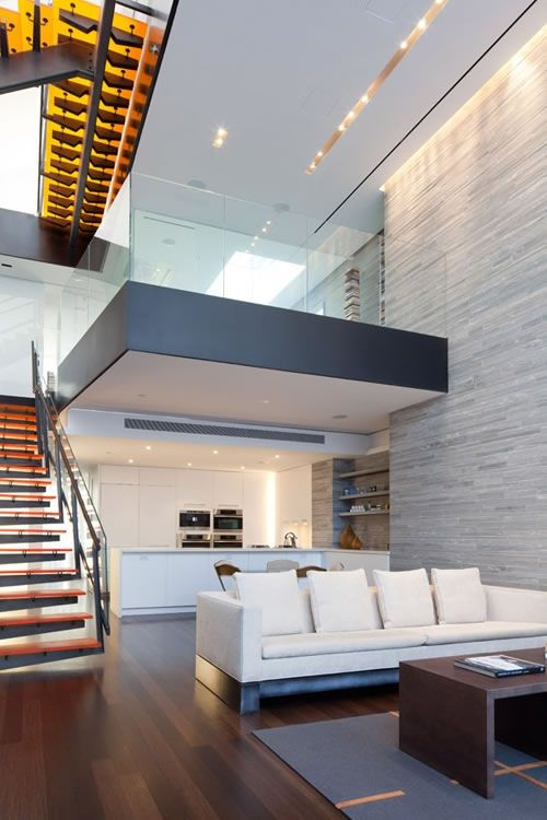 Modern condo with a huge stone accent wall (ideal for fireplace)