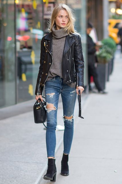 Street style | Grey turtleneck sweater, leather moto jacket, jeans, ankle boots and a handbag