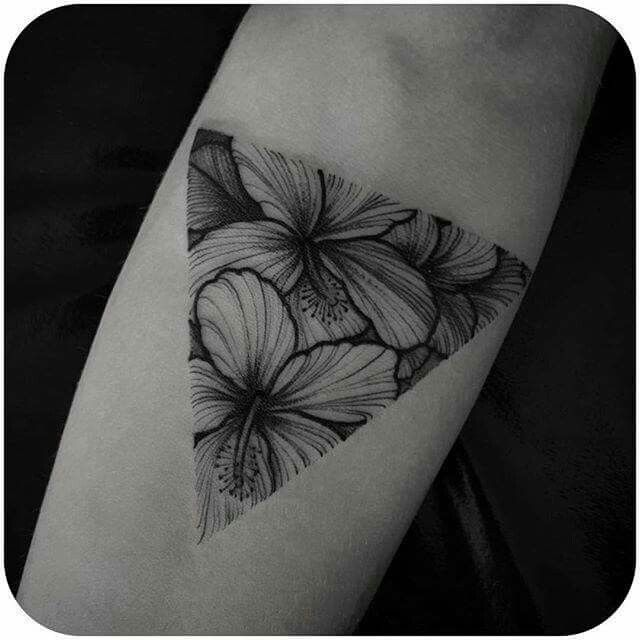 Flowers in triangle tattoo