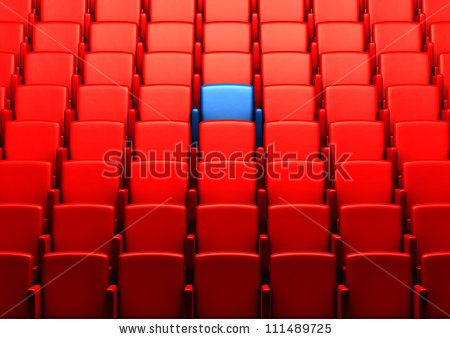 auditorium with one reserved seat by sommthink, via Shutterstock