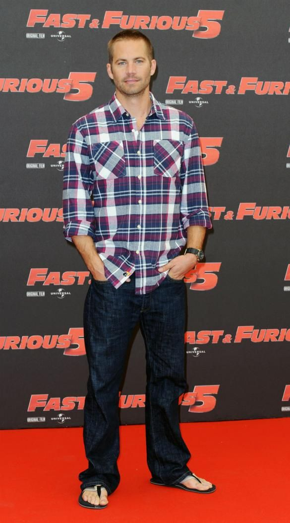 Paul Walker attending a photocall for Fast & Furious 5: Rio Heist at the Hassler hotel in Rome, Italy in April 2011. Only he could wear jeans and flip flops and still look hot!
