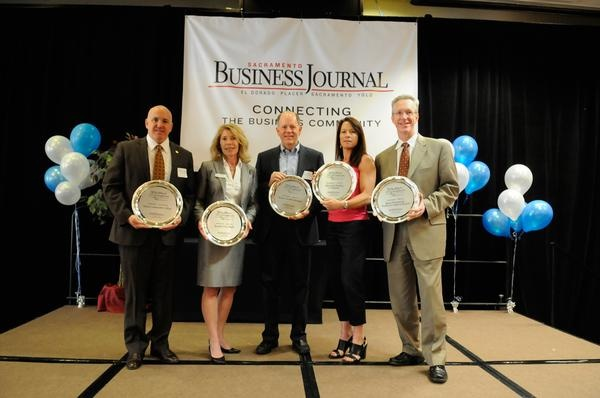 Five companies doing business in the capital region won top honors Tuesday at the Sacramento Business Journal's annual Healthiest Employers awards luncheon.     Here, representatives from the winning companies stand with their awards. From left, William Duncan of Sierra Community College, Laurie Rood of Benefits Done Right, Don Hufford of Western Health Advantage, Monique Renard of McCarthy Building Cos. Inc. and Chris Palkowski of Kaiser Permanente.