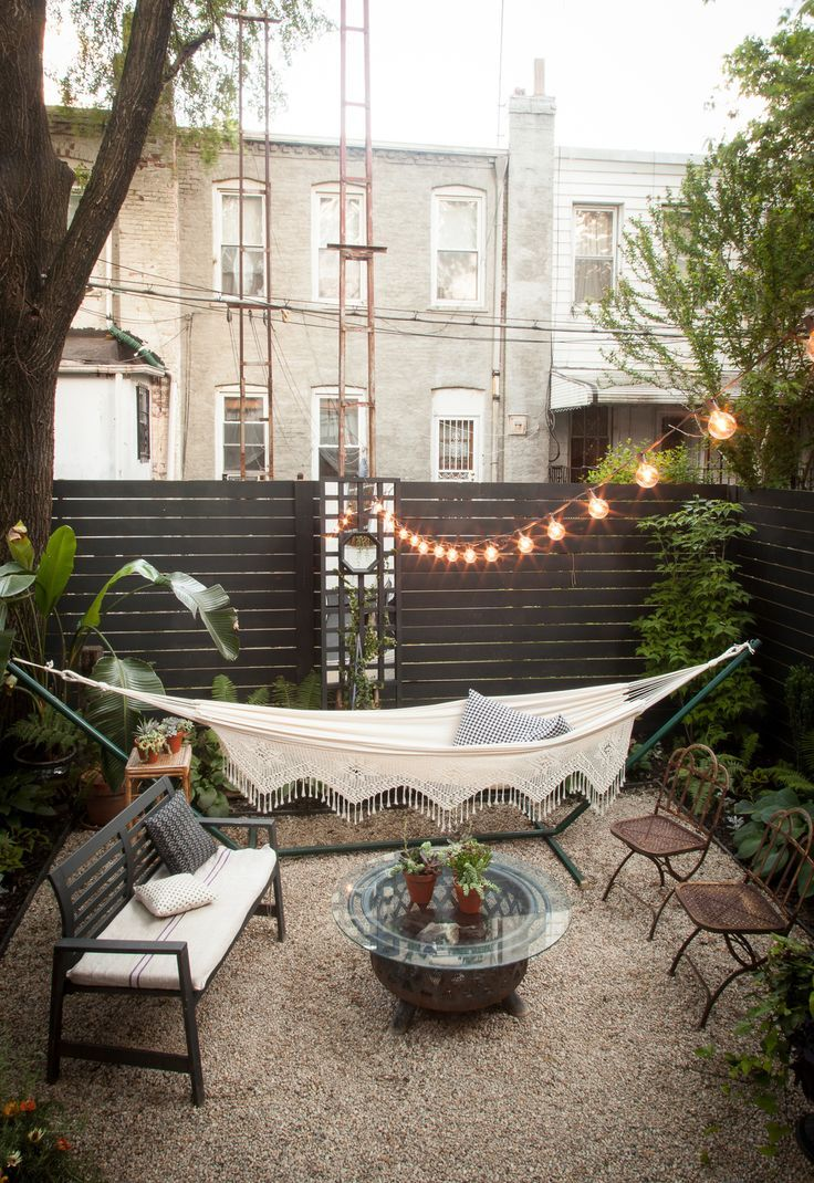 Rejuvenate your garden into an urban paradise; outdoor seating , hammock and hanging lights.