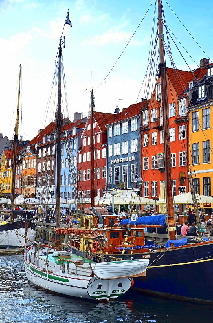 Nyhavn, or New Harbor waterfront in Copenhagen, a popular entertainment district with 17th century colorful buildings which are now occupied by cafes, pubs and restaurants.