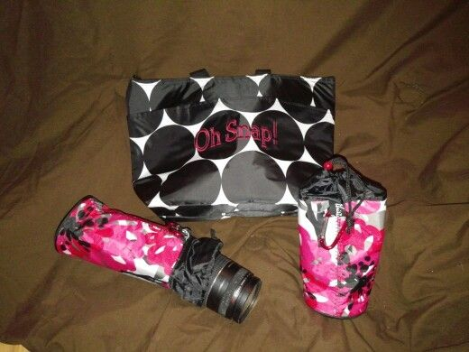 """Sharing a little Thirty One inspiration with you guys today :) I ordered a Thermal Tote and two Bring A Bottle Thermals to hold my new camera and my extra lenses while traveling. There's also a mini zipper pouch in here that holds all of my """"little parts"""" such as cords and memory card reader."""