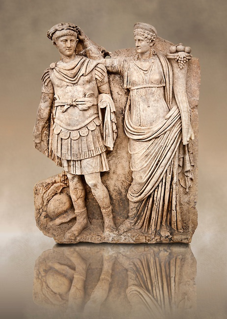 Photo of Roman releif sculpture of Aphrodite is crowned by Andreia from Aphrodisias, Turkey