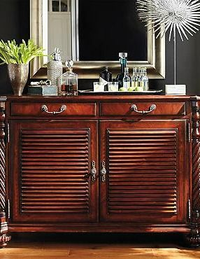 Reminiscent of British Colonial style, the Forsyth Double Bar Cabinet is functional piece handsome enough to anchor any.