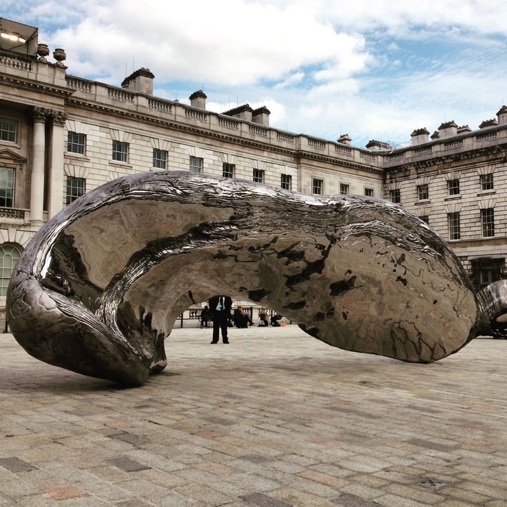 It sure looks like this giant shell by #marcquinn has decapitated the security guard #somersethouse #shell #art #design #installation #l_d_f #london #photography #hekkta #architecture #buildings #sky #clouds #contrast