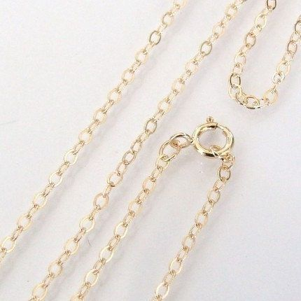 This is a dainty gold filled cable chain, the links are 1.5x1mm. It is 26 inches long and has a 5mm gold filled spring clasp      if youd like ANY