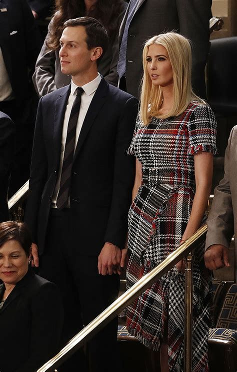 Ivanka Trump in tweed plaid black, white and red short-sleeved asymmetrical Oscar de la Renta dress with husband Jared Kushner at State of the Union 2018, January.