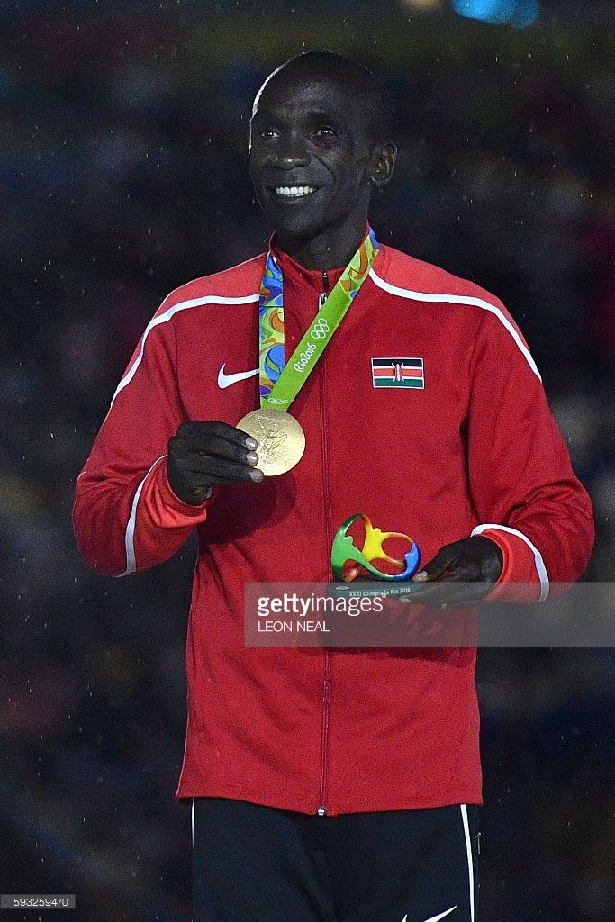 Gold medallist Kenya's Eliud Kipchoge poses on the podium for the Men's marathon athletics event during the closing ceremony of the Rio 2016 Olympic Games at the Maracana stadium in Rio de Janeiro on August 21, 2016. / AFP / Leon NEAL        (Photo credit should read LEON NEAL/AFP/Getty Images)