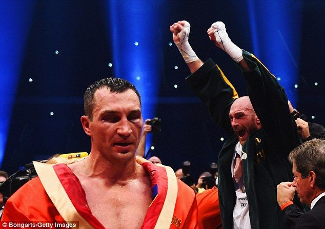 Fury celebrates after shocking the world to beat Klitschko in their first clash…