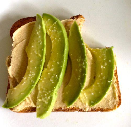 Avocado , hummus, and a dash of salt on wheat toast