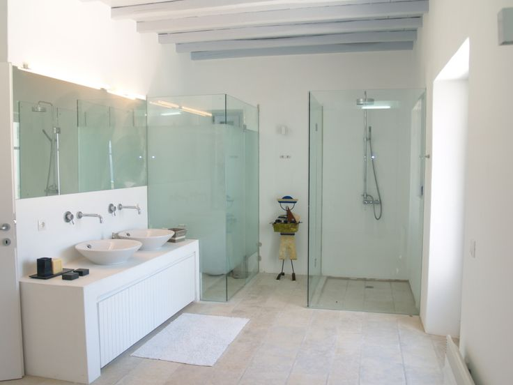 Modern style bathroom with wooden ceiling.