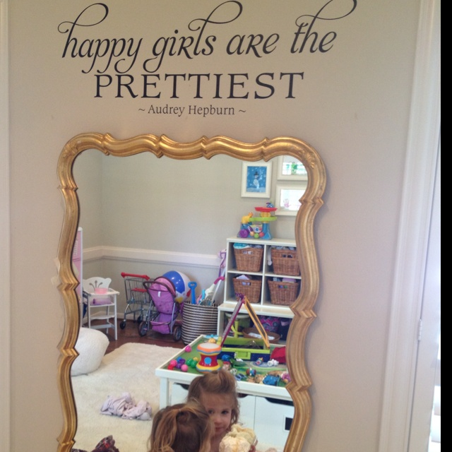 Playroom dress up station with fancy mirror.