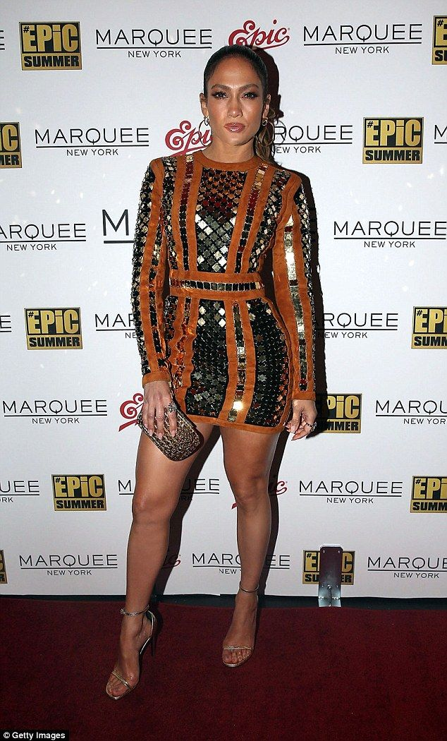Centre of attention: Jennifer Lopez wowed in a gold dress as she rocked the red…