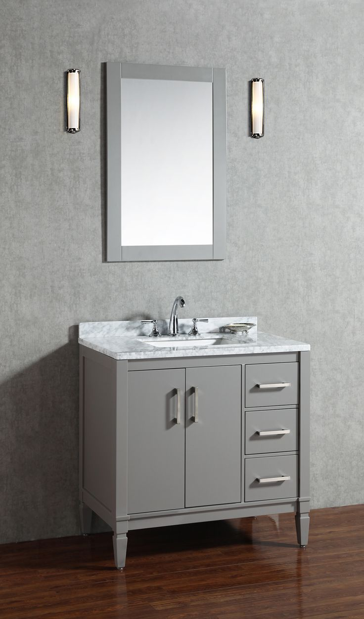 """Virta Essence Freestanding 36"""" Vanity in Grey.  Elegantly constructed of quality wood, the vanity offers an abundance of storage space with a combination of contemporary and modern design. Boasting superior design with opulent spade feet, polished chrome handles and premium soft-closing doors and drawers. Finished in a classic grey or white with a meticulously chosen carrara marble top."""
