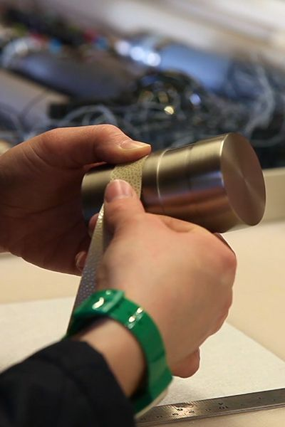 Hand wrapping a bobbin finial