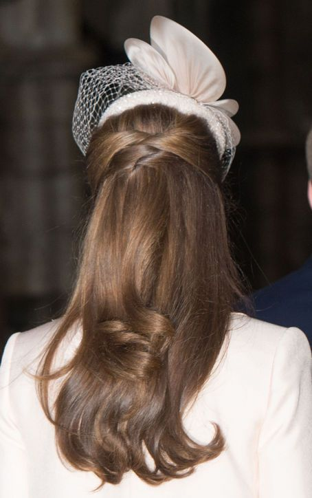 We're constantly in awe of Kate Middleton's impossibly shiny hair, and this twisty, half-up hairstyle proves why. It's conservative and interesting at the same time.