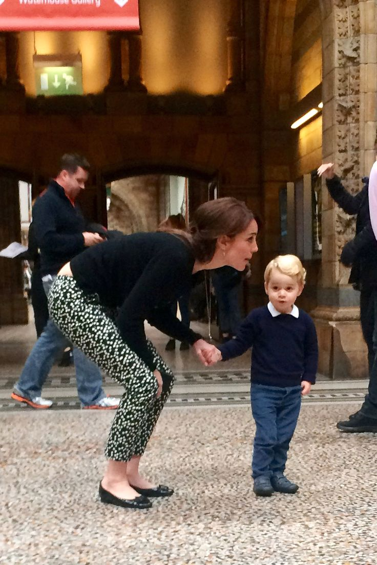 The Duchess of Cambridge and Prince George visit London's Natural History Museum on Thursday, October 22. Here, Kate shows her son a dinosaur exhibit.   - HarpersBAZAAR.com