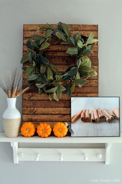 A kitchen beautifully decorated for Fall with sheet music garlands, mini pallet art, and more! Come get inspired for Fall!