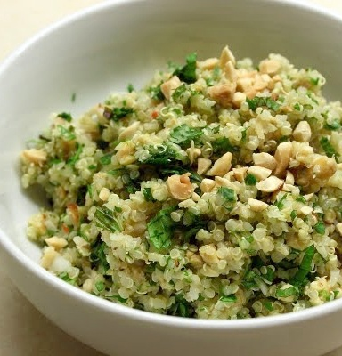 Apple and Quinoa Salad - Juice from 1 lemon, 1/3 apple cider vinegar, ½ orange juice, 1/3 cup sunflower or canola oil, 1/3 honey, 5 cups cooked quinoa, 2 apples cored and chopped, 1 bell pepper diced small (preferably orange, red or yellow), 1 cup fresh corn kernals, ½ dried cranberries, ½ currants, 1 small red onion finely chopped, 1 cup toasted chopped pecans, 1 cup fresh parsley and mint chopped, Sea salt and freshly ground pepper to taste