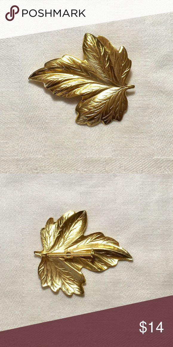 Vintage Maple Leaf Brooch Vintage maple leaf brooch has a matte gold tone. Has one tiny little spot on the front. Jewelry Brooches