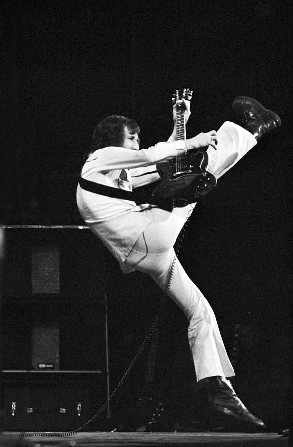 Pete Townshend - The Who. This is the right way and form to play guitar.