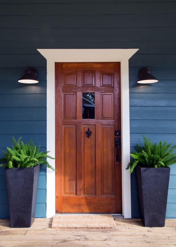 A beautiful wooden door and rustic sconces make an inviting first impression for this farmhouse featured on HGTV's Fixer Upper.  Ready to preview homes in the #Lowcountry? Call Rachel Barkley today! 843.244.0042 Charleston, SC