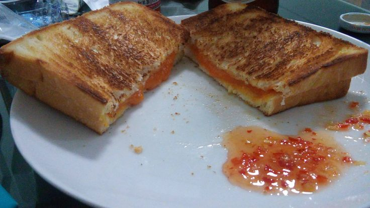 What is your condiment of choice? Red Leicester on white with sweet chili sauce. #grilledcheese #food #yum #foodporn #cheese #sandwich #recipe #lunch #foodie