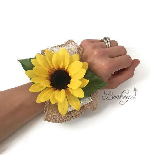 Keep your wedding flowers forever! This is a listing for a corsage made with a beautiful, bright silk mini sunflower. The sunflower is laid on a bed of a burlap ribbon and ivory lace bow. This corsage can be made as a wristlet corsage or a pin-on corsage. Please choose your preference upon checkout. It is pictured as a wristlet corsage and has been created with a stretchy silver wristlet. I can also create a wristlet using a ribbon color of your choice. Message me for details. The…