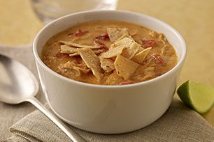 Cheesy Tortilla Soup - I made this for lunch and it was delish!! I used a block of mild cheddar instead of velveeta and added a little hot sauce for a kick! It was a hit! Will definitely make again.