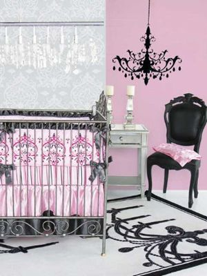 I haven't quite decided if I'd like to do a black/white & accent color nursery yet. This pink is a little too fuschia for my taste. But the idea still sticks. Love it.