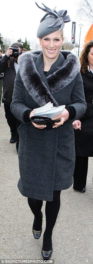 Hats off to her! Zara chose a stunning grey hat for the first day of the Cheltenham races today