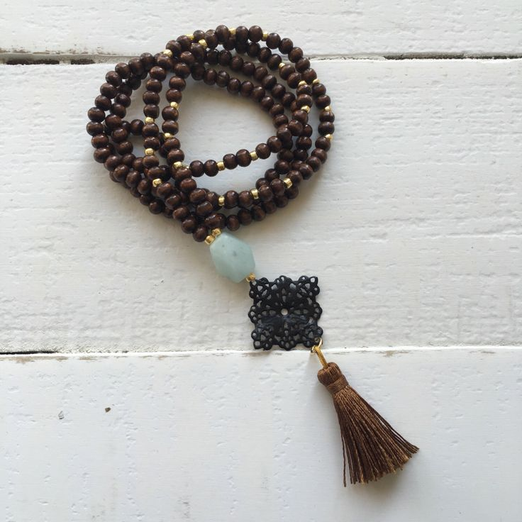 A personal favorite from my Etsy shop https://www.etsy.com/listing/498928999/mint-statement-wooden-bead-tassel