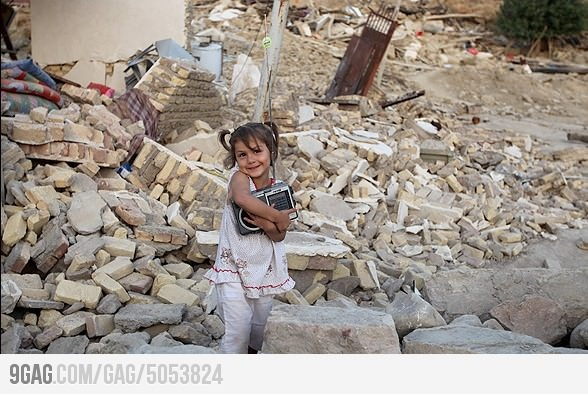 A girl's smile after earthquake in Iran