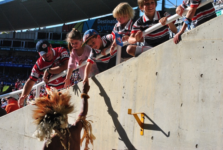 The kids say 'hi' to the fuzzy's at the footy