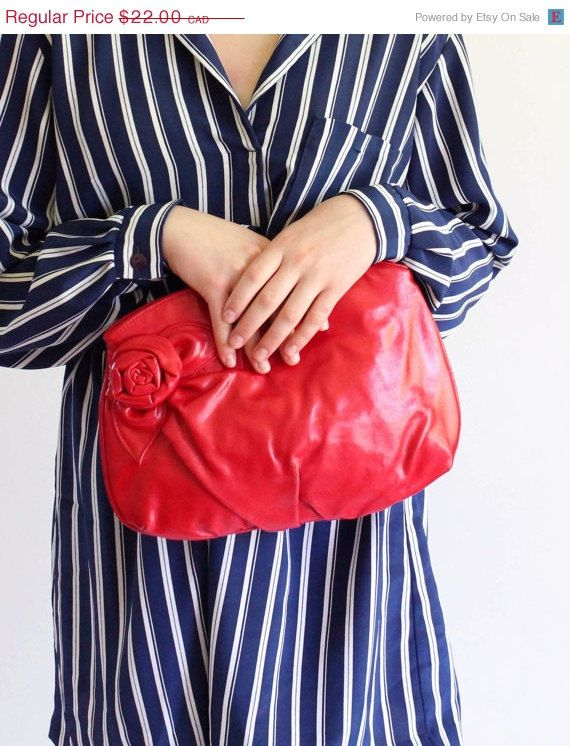 Hey, I found this really awesome Etsy listing at https://www.etsy.com/listing/152791621/on-sale-red-clutch-purse-vintage-80s