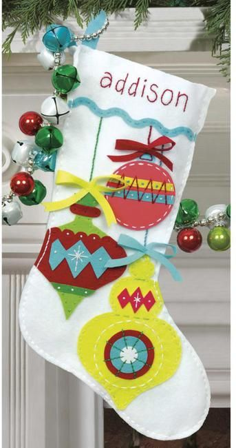 Create these beautiful appliqued stockings for entire family! Will be beautiful, especially with a little sparkle, hand sewing the ornaments on, and possibly embroidering or stitching in the names too!
