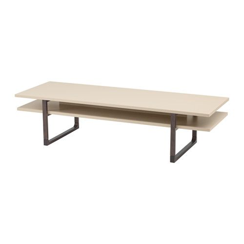 IKEA - RISSNA, Coffee table, , Separate shelf for magazines, etc. helps you keep your things organized and the table top clear.The high-gloss surfaces reflect light and give a vibrant look.The table legs are made of solid wood, a durable, natural material.