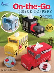 """On-the-Go Tissue Toppers These five multipurpose vehicles will be a hit with truck and train lovers. Each craft pattern is detailed to make the design look authentic. All are made using 7-count plastic canvas and 3"""" canvas circles and stitched with worsted weight yarn. $7.95"""