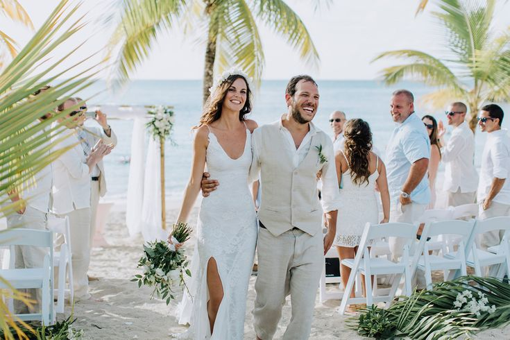 Alex and Maria's laid back, intimate beach wedding, featuring our understated Lottie gown.
