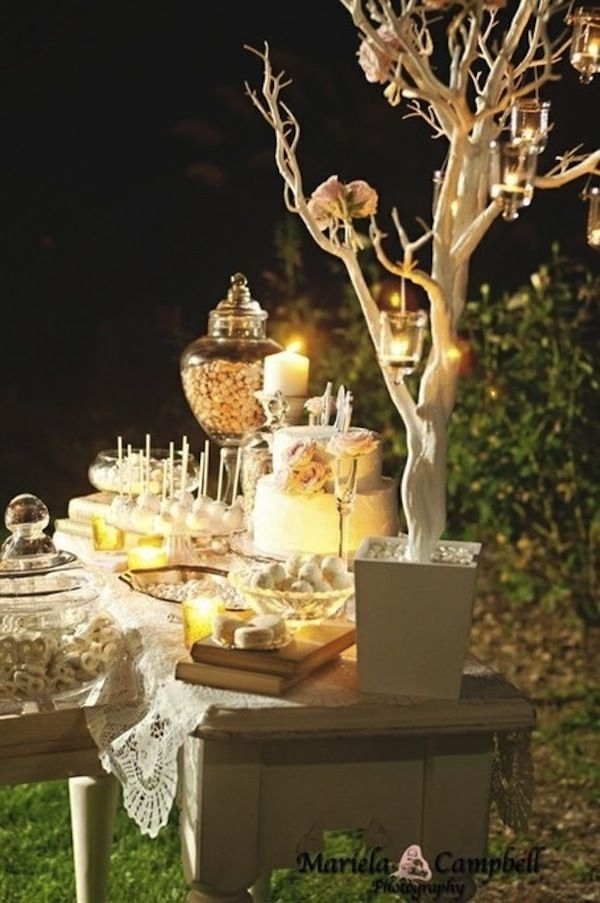 Want to make a candy bar like this one? Ask us about our tables, our glass jars, our footed cake stands, and our hanging votives!