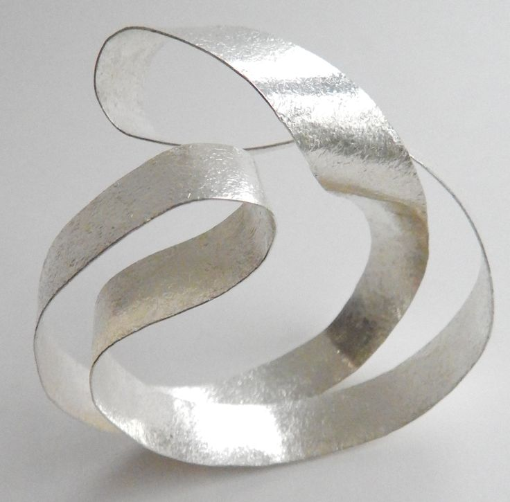 "Reiko Ishiyama- JAPAN  ""My work has an almost fragile quality, stressing lightness and mobility. By shaping paper thin sheets of silver, I can house space itself."" Smithsonian Craft2Wear, Oct 1-3, 2015, Washington, DC.  http://swc.si.edu/craft2wear"