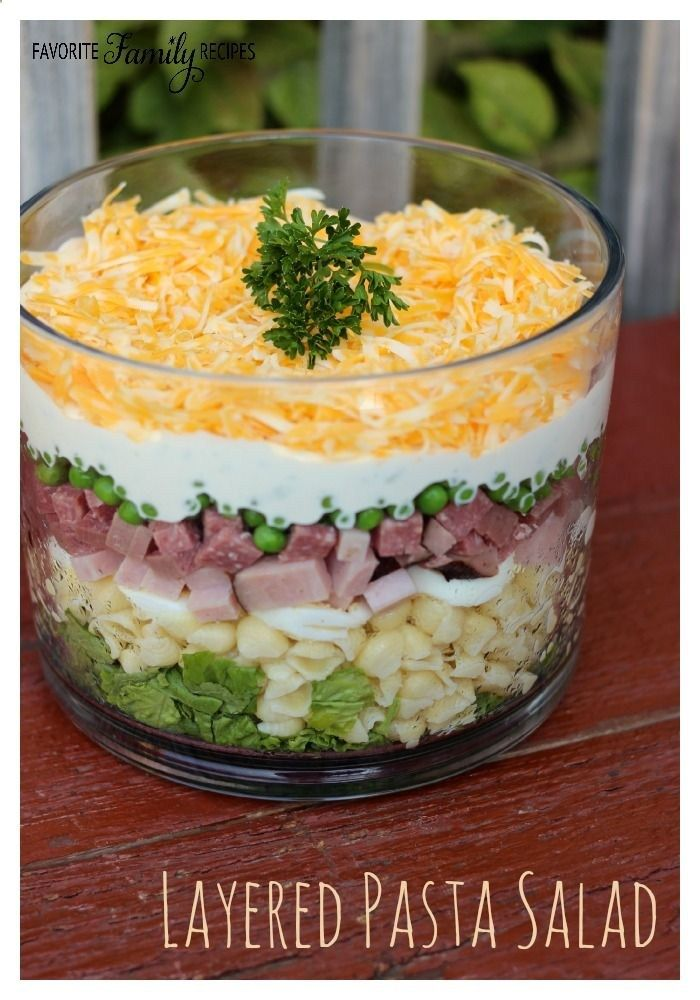 This Layered Pasta Salad is a complementary side dish at BBQs and potlucks, but it really is a full and hearty meal in itself. Check out more recipes like this! Visit yumpinrecipes.com/