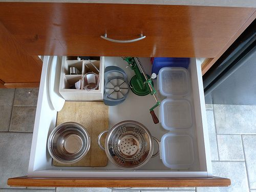 Bottom kitchen drawer used for children so that they can easily access tools for snack making. Brilliant!