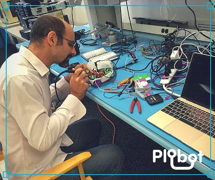 Our CEO Rudi (Rodolfo Cossovich), working on the Plobots.